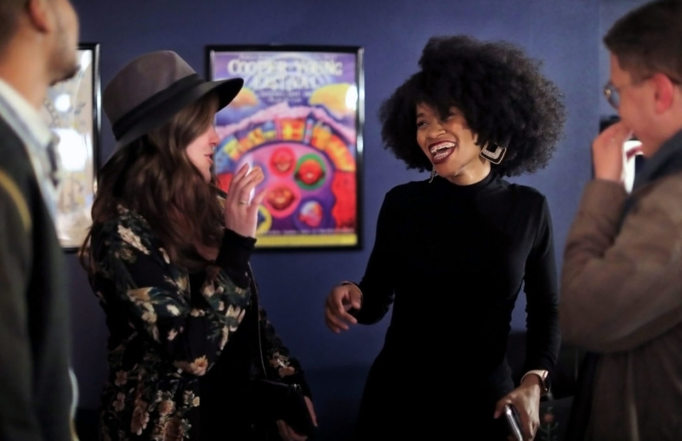 <strong>Deidra Hawkins (center right) laughs with a group of friends after speaking at What I Bring: A night of storytelling with Chalkbeat &amp; Spillit on Feb. 1, 2020.</strong> (Patrick Lantrip/Daily Memphian)