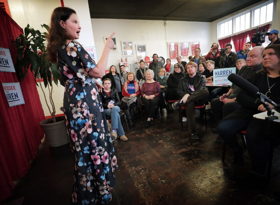 <strong>A crowd of Elizabeth Warren supporters listen as actor Ashley Judd draws comparisons between her life and that of the Massachusetts senator during a campaign rally at Makeda's Cookies on Feb. 26, 2020.</strong> (Jim Weber/Daily Memphian)