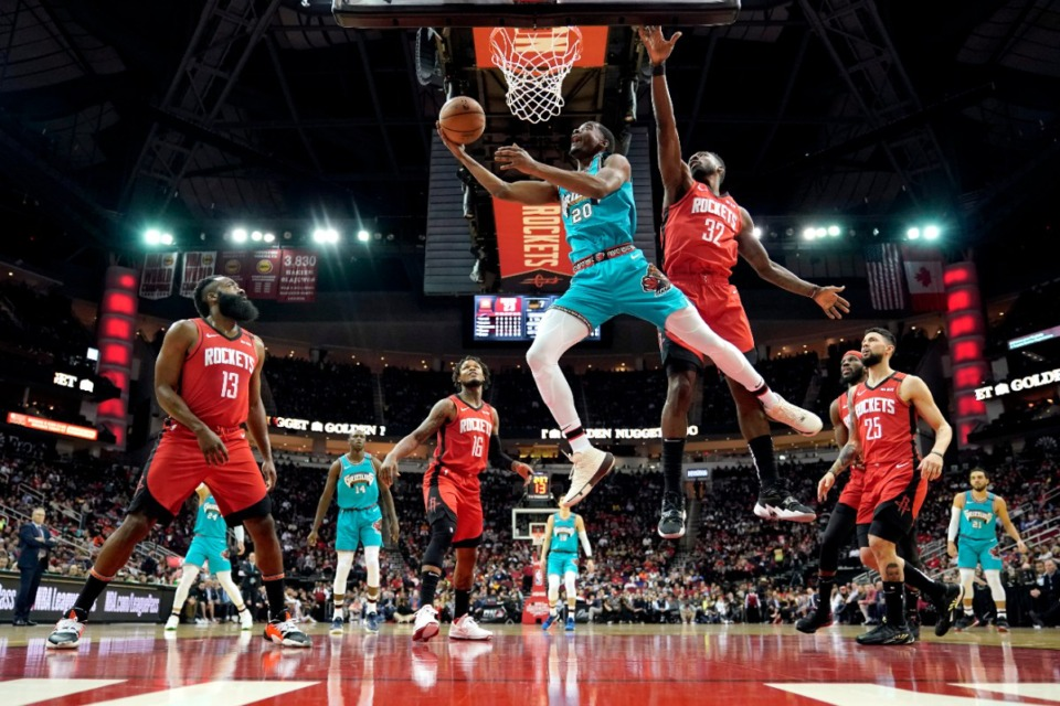 <strong>Memphis Grizzlies' Josh Jackson (20) goes up for a shot as Houston Rockets' Jeff Green (32) defends during the first half of an NBA basketball game Wednesday, Feb. 26, 2020, in Houston.</strong> (AP Photo/David J. Phillip)