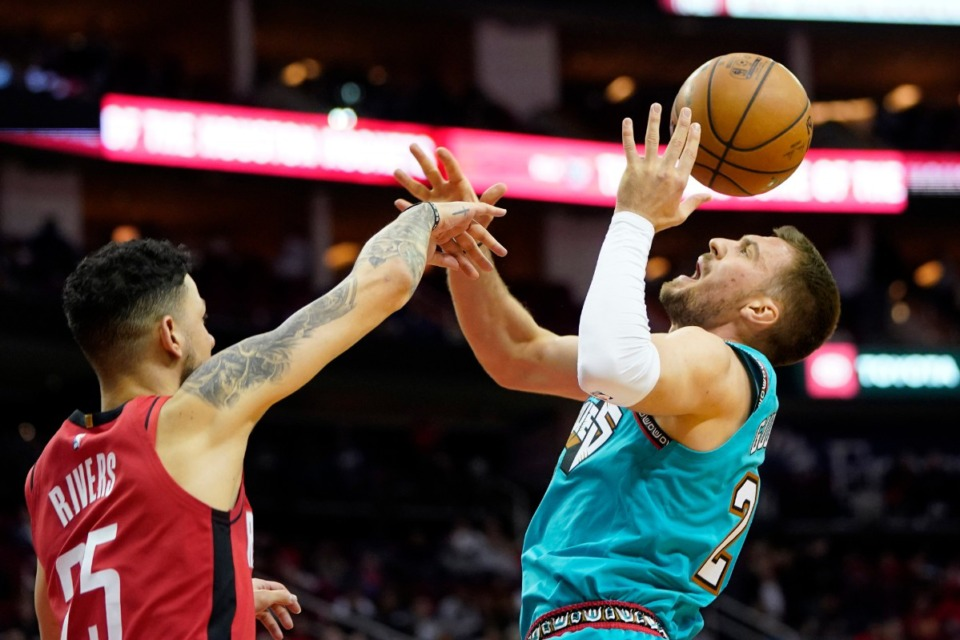 <strong>Memphis Grizzlies' Marko Guduric (23) is fouled by Houston Rockets' Austin Rivers (25) during the second half of an NBA basketball game Wednesday, Feb. 26, 2020, in Houston. The Rockets won 140-112.</strong> (AP Photo/David J. Phillip)
