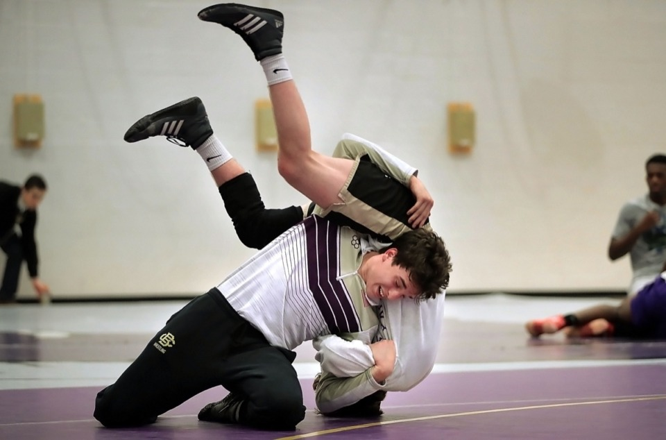 <strong>Garrett Bowers from CBHS works out with Evan Anthony on Feb. 12, 2020, at CBHS. Bowers became just the fourth wrestler in school history to win three state championships.</strong> (Jim Weber/Daily Memphian file)