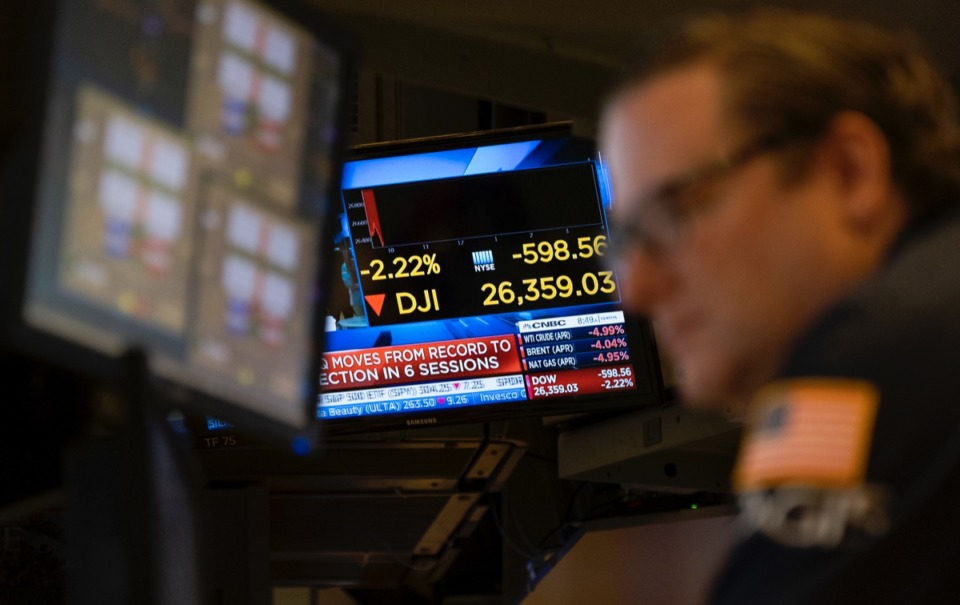 <strong>Stocks reflect declines on monitors as traders work on the floor of the New York Stock Exchange Thursday, Feb. 27, 2020.</strong> (Craig Ruttle/AP)