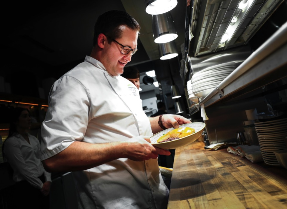 <strong>Coastal Fish Company Executive Chef Ryan Gall prepares dishes Wednesday, Feb. 26, 2020, in the FedEx Event Center at Shelby Farms.</strong> (Mark Weber/Daily Memphian)