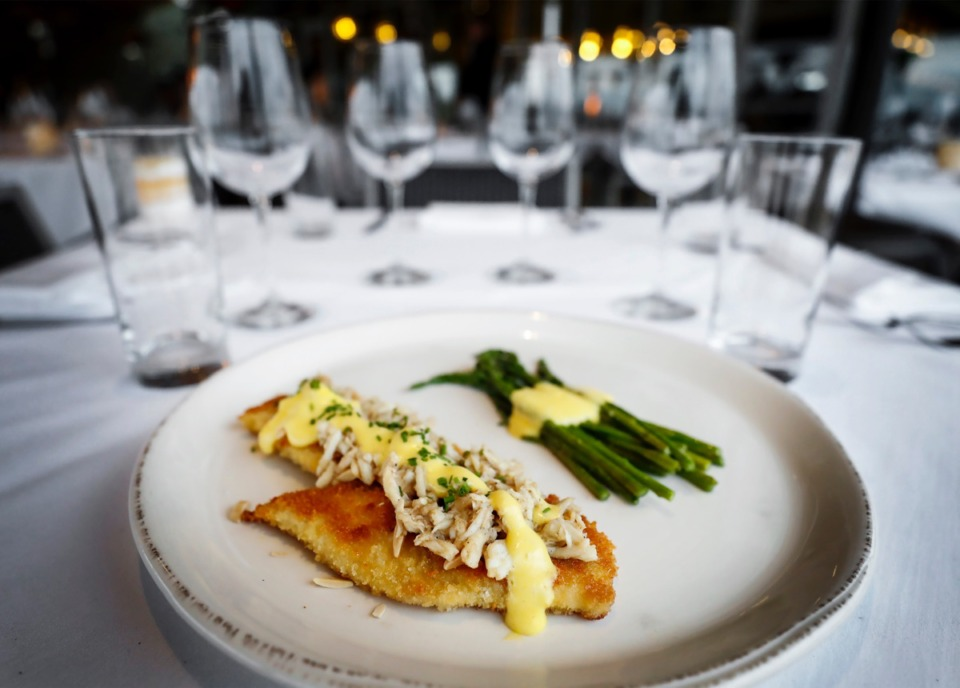 <strong>Coastal Fish Company's speckled trout amandine is a large filet&nbsp;coated with thin almond slices, roasted and topped generously with crab.</strong> (Mark Weber/Daily Memphian)