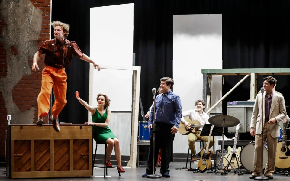 """<strong>Christian Brothers High School student Eli Hendon (left), who portrays Jerry Lee Lewis, jumps of a piano during rehearsal on Feb. 18, 2020, for the musical """"Million Dollar Quartet.""""&nbsp;</strong>(Mark Weber/Daily Memphian)"""