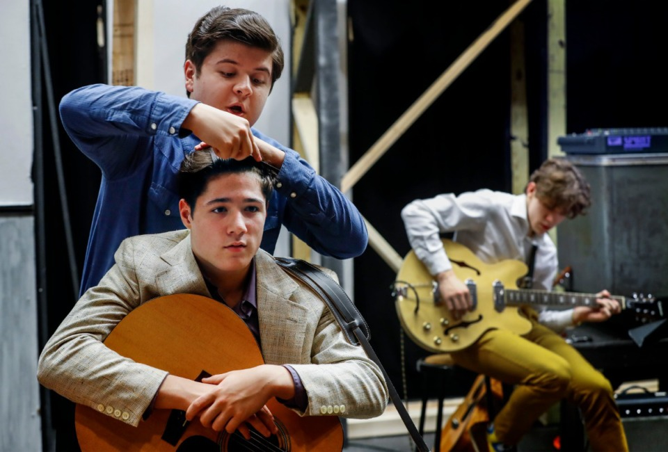 """<strong>Christian Brothers High School student Cameron Cavins (bottom), who plays Elvis, gets help with his hair from cast mate Gabe McCarthy (top), who plays Carl Perkins, before rehearsal of the musical """"Million Dollar Quartet"""" on Feb. 18, 2020.</strong> (Mark Weber/Daily Memphian)"""