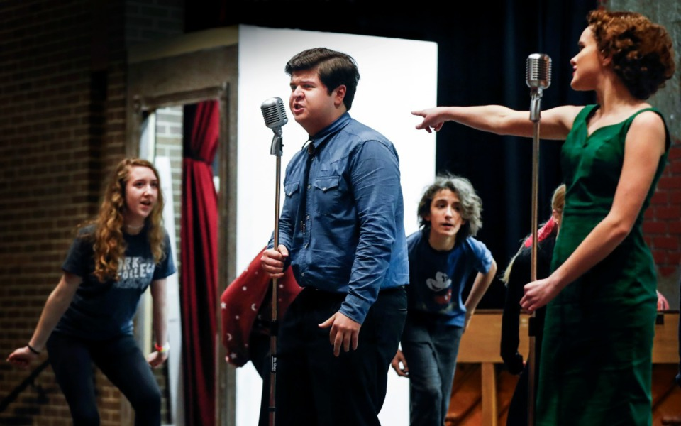 """<strong>Christian Brothers High School student Gabe McCarthy (middle), who plays Carl Perkins, sings during rehearsal of """"Million Dollar Quartet"""" on Feb. 18, 2020.</strong> (Mark Weber/Daily Memphian)"""