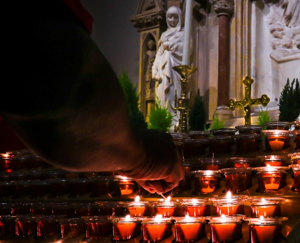 <strong>In this Wednesday, Nov. 27, 2019, photo, a Catholic faithful lights candles at a prayer station during a visit to one of the great symbols of the Roman Catholic Church, St. Patrick's Cathedral, in New York.</strong> (Bebeto Matthews/AP)