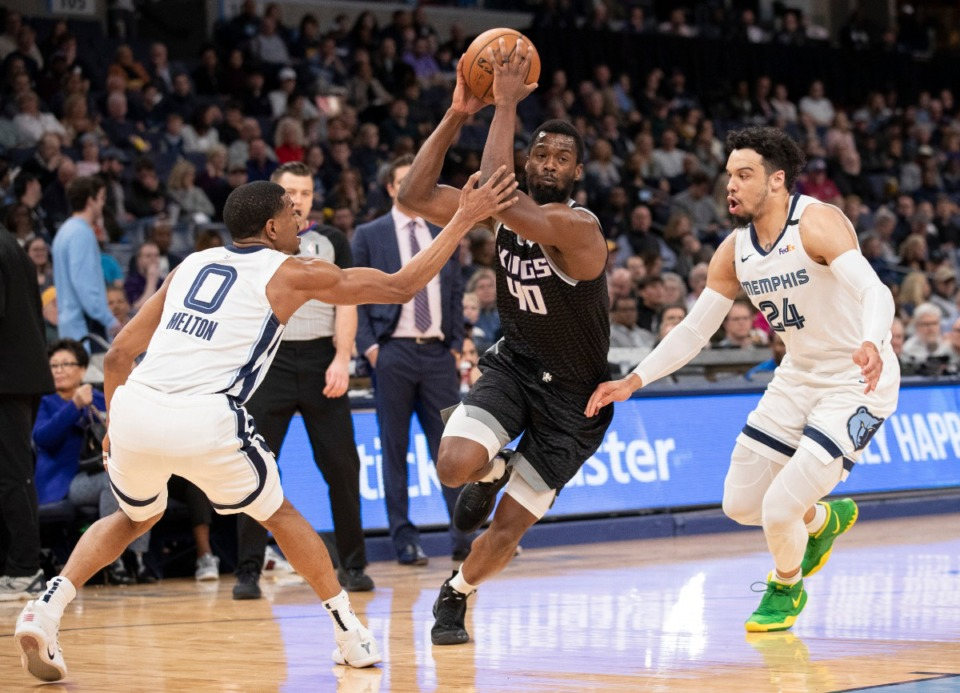 <strong>Sacramento Kings forward Harrison Barnes (40) drives to the basket while defended by Memphis Grizzlies guards De'Anthony Melton (0) and Dillon Brooks (24) Feb. 28, 2020, at FedExForum.</strong> (Nikki Boertman/AP)