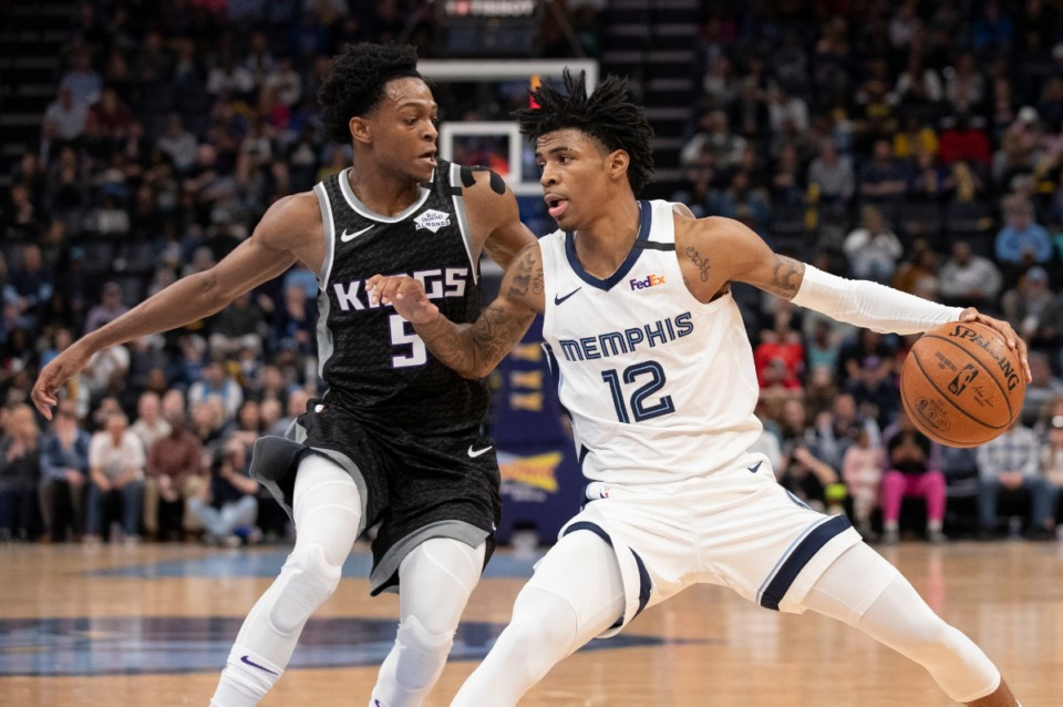 <strong>Memphis Grizzlies guard Ja Morant (12) is defended by Sacramento Kings guard De'Aaron Fox (5) Friday, Feb. 28, 2020, at FedExForum.</strong> (Nikki Boertman/AP)