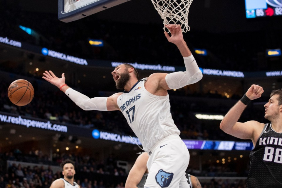 <strong>Memphis Grizzlies center Jonas Valanciunas (17) loses the ball after being fouled by Sacramento Kings forward Nemanja Bjelica (88) Feb. 28, 2020, at FedExForum.</strong> (Nikki Boertman/AP)