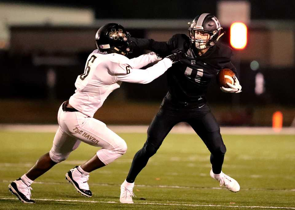 Whitehaven defensive back Josh Gray (left) came up with a key interception late as the Tigers defeated Grayson Hitt in Houston in last week's second round of the 6A playoffs. Whitehaven visits Germantown on Friday.