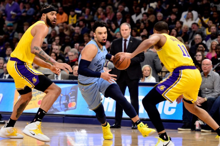 <strong>Memphis Grizzlies guard Dillon Brooks (24) drives between Los Angeles Lakers center JaVale McGee, left, and guard Avery Bradley (11)in the first half of an NBA basketball game Saturday, Feb. 29, 2020, in Memphis.</strong> (AP Photo/Brandon Dill)
