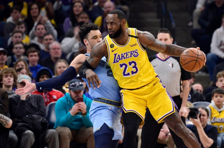 <strong>Los Angeles Lakers forward LeBron James (23) handles the ball against Memphis Grizzlies guard Dillon Brooks in the first half of an NBA basketball game Saturday, Feb. 29, 2020, in Memphis.</strong> (AP Photo/Brandon Dill)