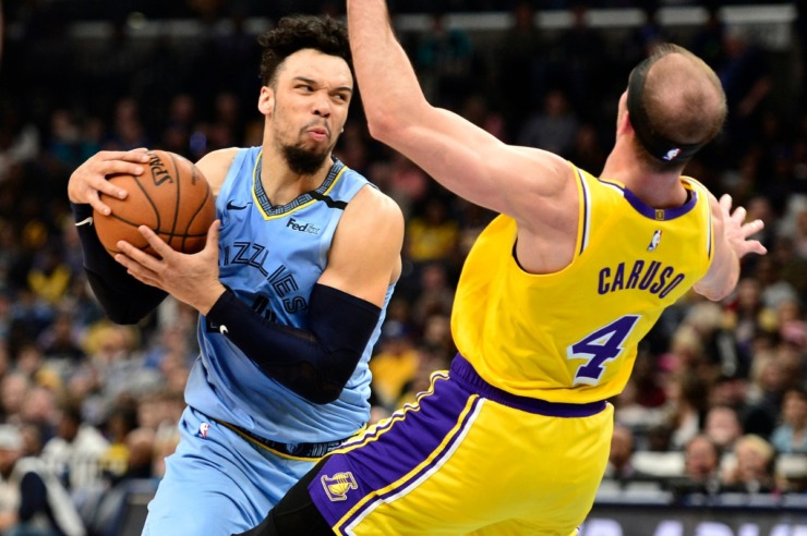 <strong>Memphis Grizzlies guard Dillon Brooks, left, drives against Los Angeles Lakers guard Alex Caruso (4) in the first half of an NBA basketball game Saturday, Feb. 29, 2020, in Memphis.</strong> (AP Photo/Brandon Dill)