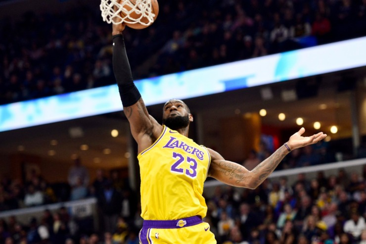 <strong>Los Angeles Lakers forward LeBron James (23) rebounds the ball in the first half of an NBA basketball game against the Memphis Grizzlies, Saturday, Feb. 29, 2020, in Memphis.</strong> (AP Photo/Brandon Dill)
