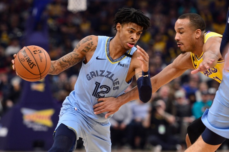 <strong>Memphis Grizzlies guard Ja Morant (12) handles the ball against Los Angeles Lakers guard Avery Bradley (11) in the first half of an NBA basketball game Saturday, Feb. 29, 2020, in Memphis.</strong> (AP Photo/Brandon Dill)