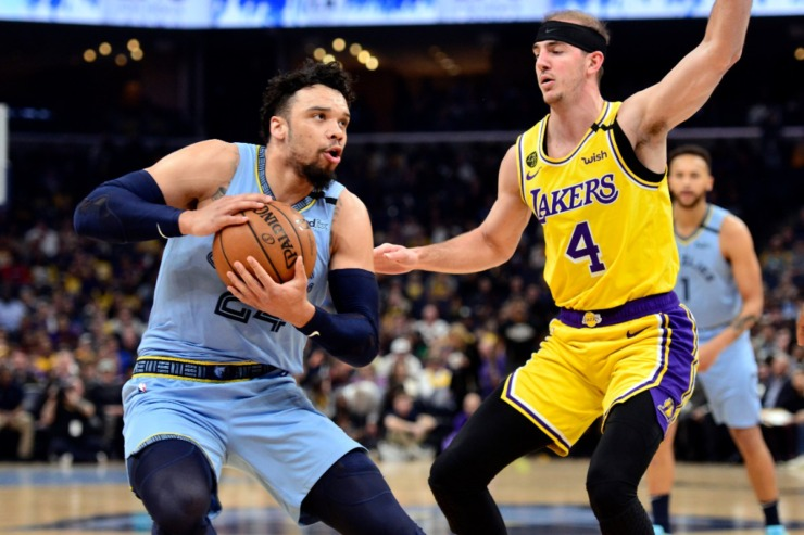 <strong>Memphis Grizzlies guard Dillon Brooks, left, handles the ball against Los Angeles Lakers guard Alex Caruso (4) in the first half of an NBA basketball game Saturday, Feb. 29, 2020, in Memphis.</strong> (AP Photo/Brandon Dill)