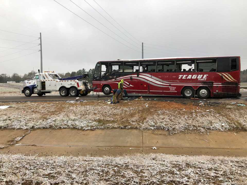 <strong>A tour bus is towed away Wednesday, Nov. 14, after it overturned on an icy stretch of Interstate 269 in DeSoto County. Two people were killed and 44 were injured.</strong> (AP Photo/Adrian Sainz)