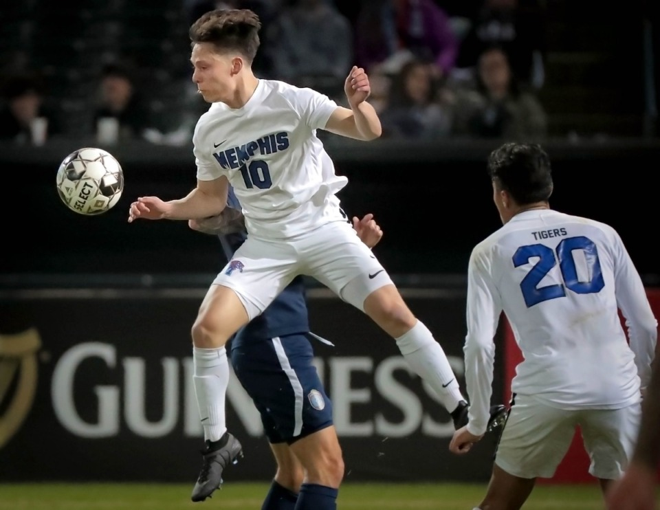 <strong>The Tigers' Jackson Peterson (10) controls a header during 901 FC's preseason exhibition game against the University of Memphis at AutoZone Park on Feb. 29, 2020.</strong> (Jim Weber/Daily Memphian)