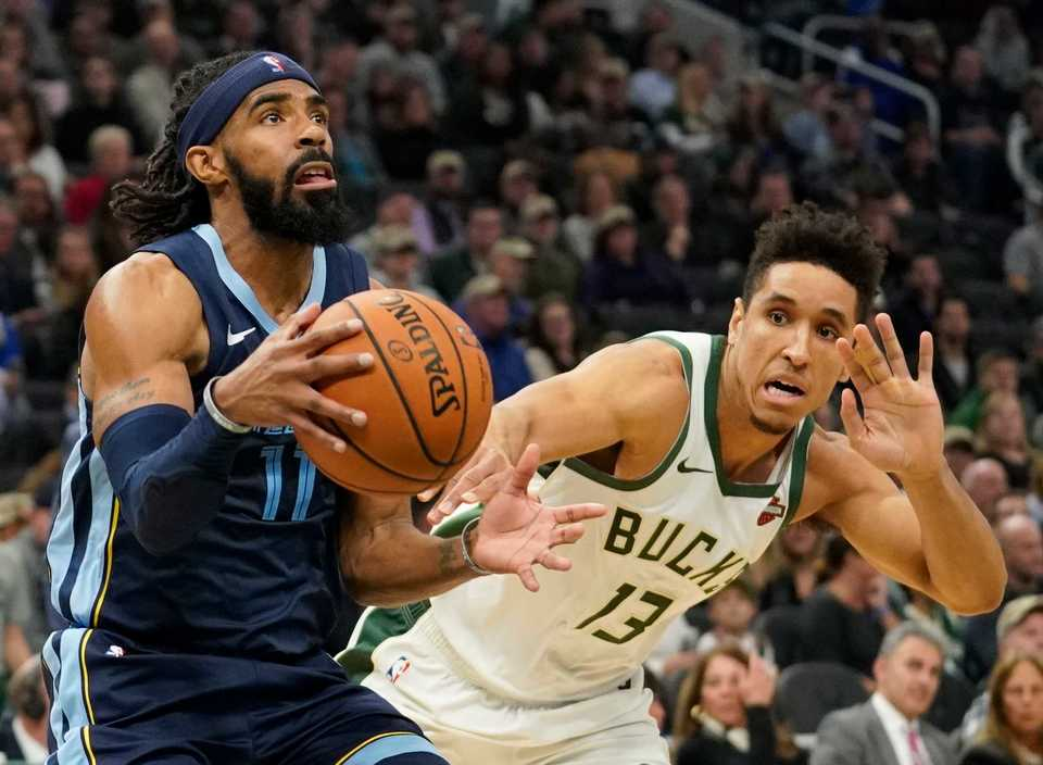 <span><strong>Memphis Grizzlies' Mike Conley drives past Milwaukee Bucks' Malcolm Brogdon during the first half of an NBA basketball game Wednesday, Nov. 14, 2018, in Milwaukee.</strong> (AP Photo/Morry Gash)</span>