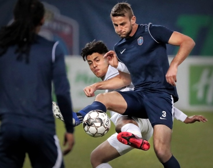 <strong>Memphis 901 FC defender Zach Carroll (3) battles for control of the ball against the Tigers' Jovan Prado (20) during 901 FC's preseason exhibition game against the University of Memphis at AutoZone Park on Feb. 29, 2020.</strong> (Jim Weber/Daily Memphian)