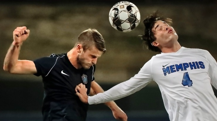 <strong>Memphis 901 FC defender Zach Carroll (3) battles for first touch with the Tigers' Artur De Luca (4) during 901 FC's preseason exhibition game against the University of Memphis at AutoZone Park on Feb. 29, 2020.</strong> (Jim Weber/Daily Memphian)