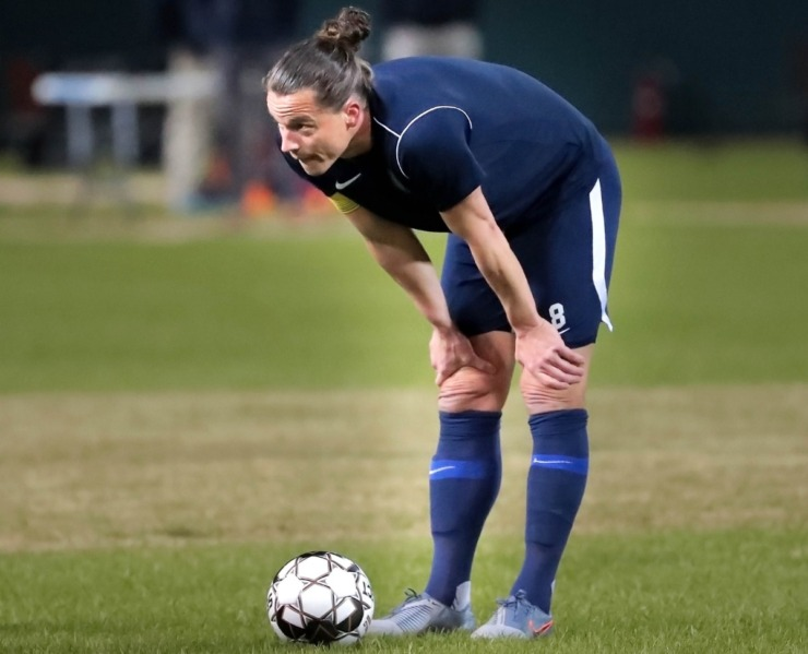 <strong>Memphis 901 FC defender Marc Burch (8) eyeballs a direct kick through a wall of Tiger defenders during 901 FC's preseason exhibition game against the University of Memphis at AutoZone Park on Feb. 29, 2020.</strong> (Jim Weber/Daily Memphian)