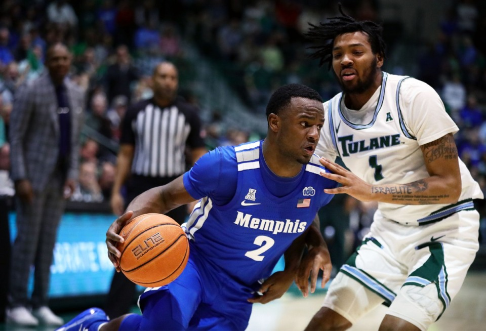 <strong>University of Memphis' Alex Lomax (2) drives to the basket during a road game against the Tulane University Green Wave in New Orleans Feb. 29, 2020.</strong> (Patrick Lantrip/Daily Memphian)