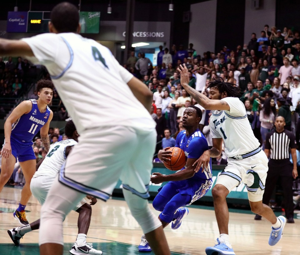 <strong>University of Memphis guard Alex Lomax (2) drives to the rim during a road game against the Tulane University Green Wave in New Orleans Feb. 29, 2020.</strong> (Patrick Lantrip/Daily Memphian)