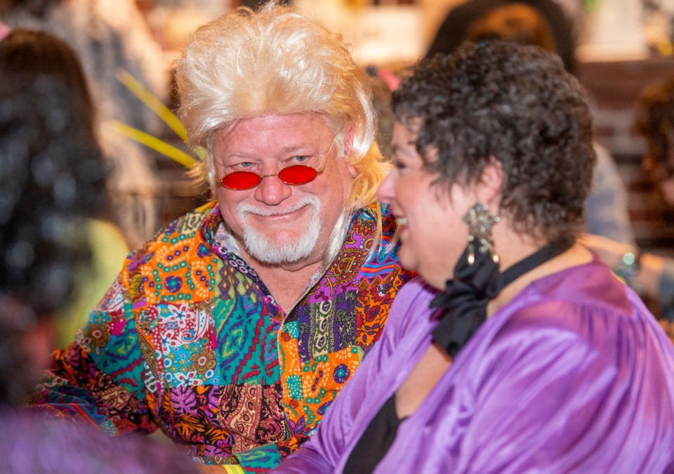 <strong>Mike Ross gets into the part with his friend Karen Mathis at the Collierville Cares 80's Prom fundraiser Saturday, Feb. 29, 2020.</strong> (Greg Campbell/Special to The Daily Memphian)
