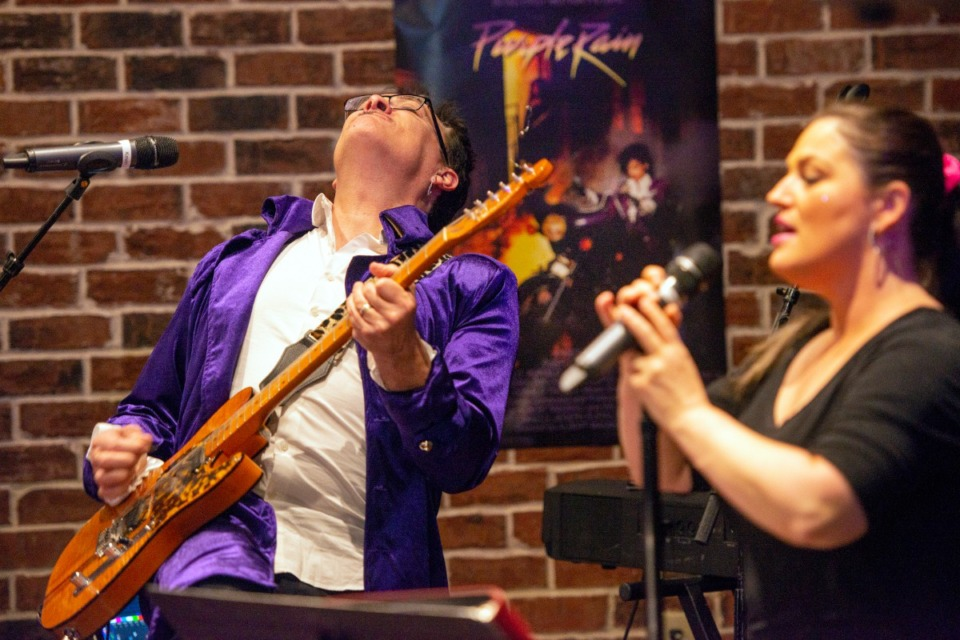 <strong>Feeling the music of Prince, Kevin Paige performs with his wife Bethany at the Collierville Cares 80's prom fundraiser Saturday, Feb. 29, 2020. </strong>(Greg Campbell/Special to The Daily Memphian)