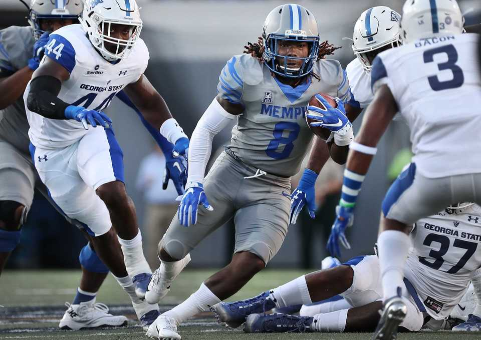 University of Memphis running back Darrell Henderson looks for an opening during the Tigers game against Georgia State at the Liberty Bowl Memorial Stadium on September 14, 2018. The University of Memphis beat Georgia, 59-22. (Jim Weber/Daily Memphian)