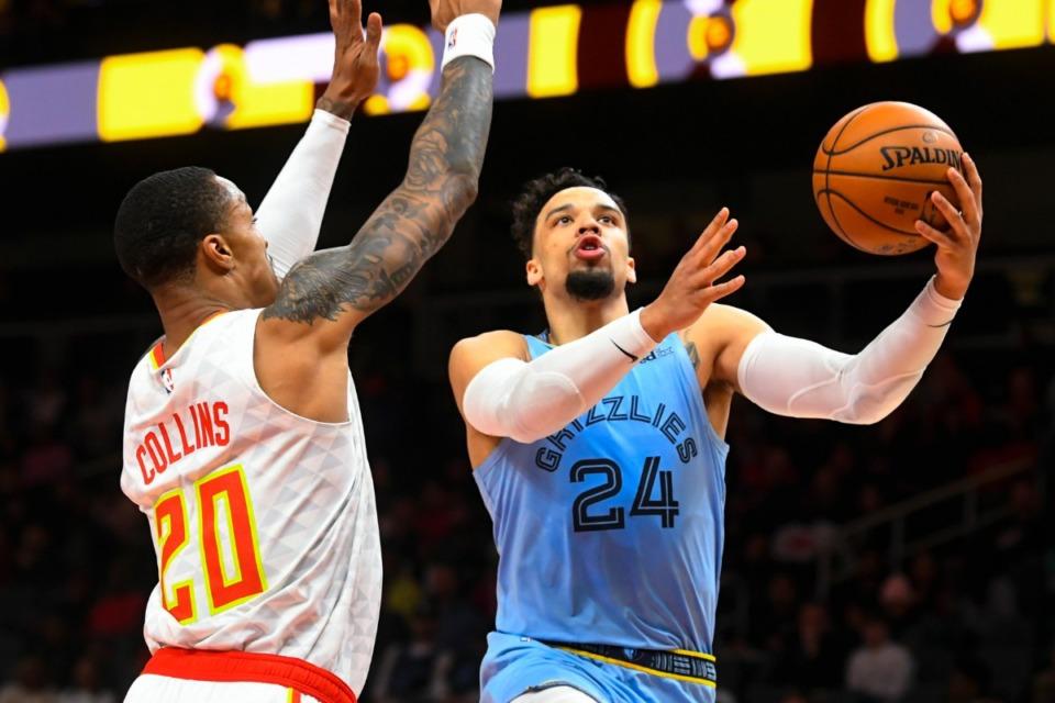 <strong>Memphis Grizzlies guard Dillon Brooks (24) shoots around Atlanta Hawks forward John Collins March 2, 2020, in Atlanta.</strong> (John Amis/AP)