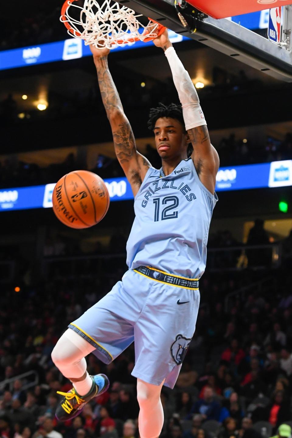 <strong>Memphis Grizzlies guard Ja Morant (12) dunks in the game against the Atlanta Hawks March 2, 2020, in Atlanta.</strong>&nbsp;(John Amis/AP)