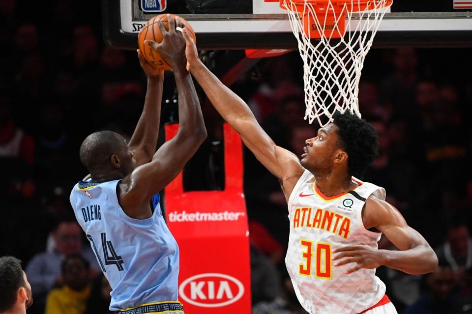 <strong>Atlanta Hawks center Damian Jones (30) tries to block Memphis Grizzlies center Gorgui Dieng March 2, 2020, in Atlanta.</strong>&nbsp;(John Amis/AP)