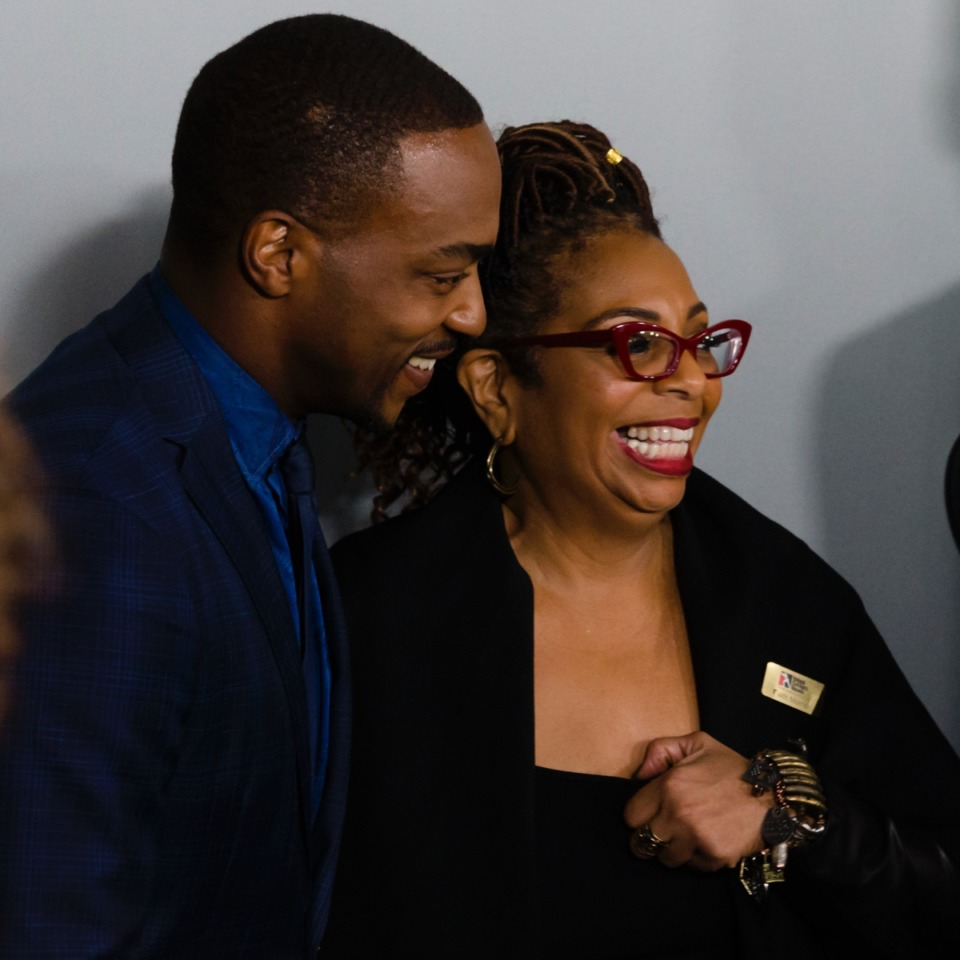 "<strong>""The Banker"" producer and actor Anthony Mackie laughs with Faith Morris, Chief Marketing &amp; External Affairs Officerat the National Civil Rights Museum on March 2, 2020. (Ziggy Tucker/Daily Memphian)</strong>"