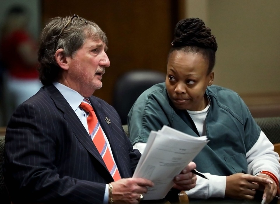 <strong>Latoshia Daniels gets an update from attorney Leslie Ballin in Judge Glenn Wright's courtroom at 201 Poplar Wednesday, Aug. 21. Ballin asked Tuesday, March 3, 2020, for additional time for discovery.</strong> (Patrick Lantrip/Daily Memphian file)