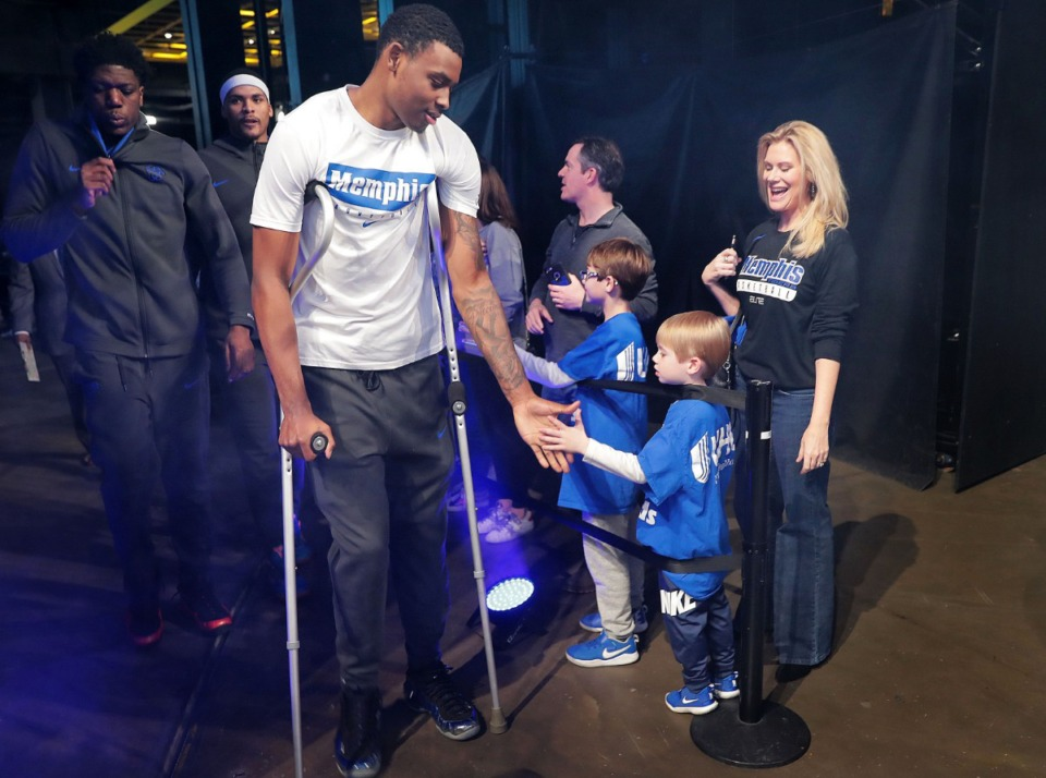 <strong>Injured University of Memphis forward D.J. Jeffries is greeted by fans before the start of the Tigers' game on Feb. 8, 2020, against USF at the FedExForum.&nbsp;</strong>(Jim Weber/Daily Memphian)