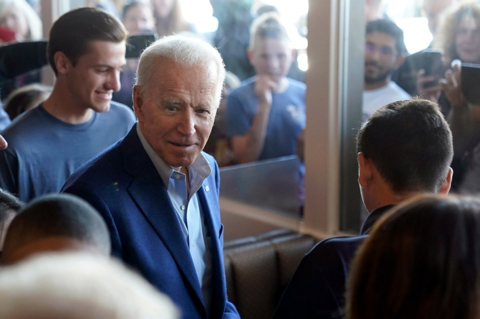 <strong>Democratic presidential candidate former Vice President Joe Biden talks with customers as people watch through the window's at the Buttercup Diner during a campaign stop in Oakland, Calif., Tuesday, March 3, 2020.</strong> (Tony Avelar/AP)
