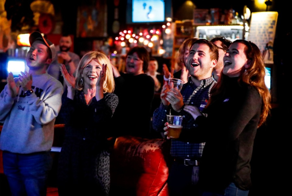 <strong>Supporters of former Vice President Joe Biden cheer as the presidential hopeful is projected as the Tennessee Super Tuesday winner during a watch party on Tuesday March. 3, 2020, at the Rec Room.</strong> (Mark Weber/Daily Memphian)