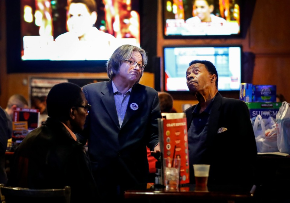 <strong>General Sessions Court clerk hopeful Del Gill (right) watches voter returns with Charley Burch (left) during a Super Tuesday watch party on Tuesday March. 3, 2020, at the Craft Republic.</strong> (Mark Weber/Daily Memphian)