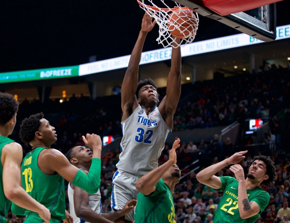 <strong>Memphis center James Wiseman (32) dunks against Oregon Nov. 12, 2019. The NCAA said he couldn't play for what seemed to be arbitrary reasons, and the Tigers' season went downhill from there.</strong>&nbsp;(AP Photo/Craig Mitchelldyer)