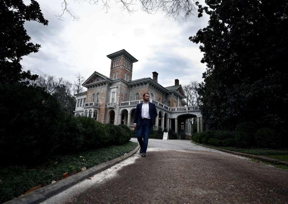 <strong>Real estate agent Joshua Spotts of Crye-Leike Realtors walks the grounds of the historic Annesdale Mansion in Midtown Memphis March 4, 2020. Spotts will be selling the property on behalf of owner Ken Robison.</strong> (Patrick Lantrip/Daily Memphian)