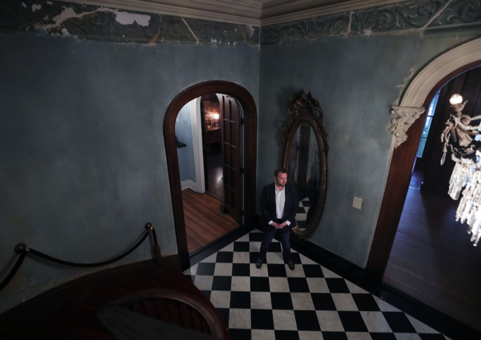 <strong>Real estate agent Joshua Spotts of Crye-Leike Realtors stands in the stately entrance of the historic Annesdale Mansion March 4, 2020.</strong> (Patrick Lantrip/Daily Memphian)
