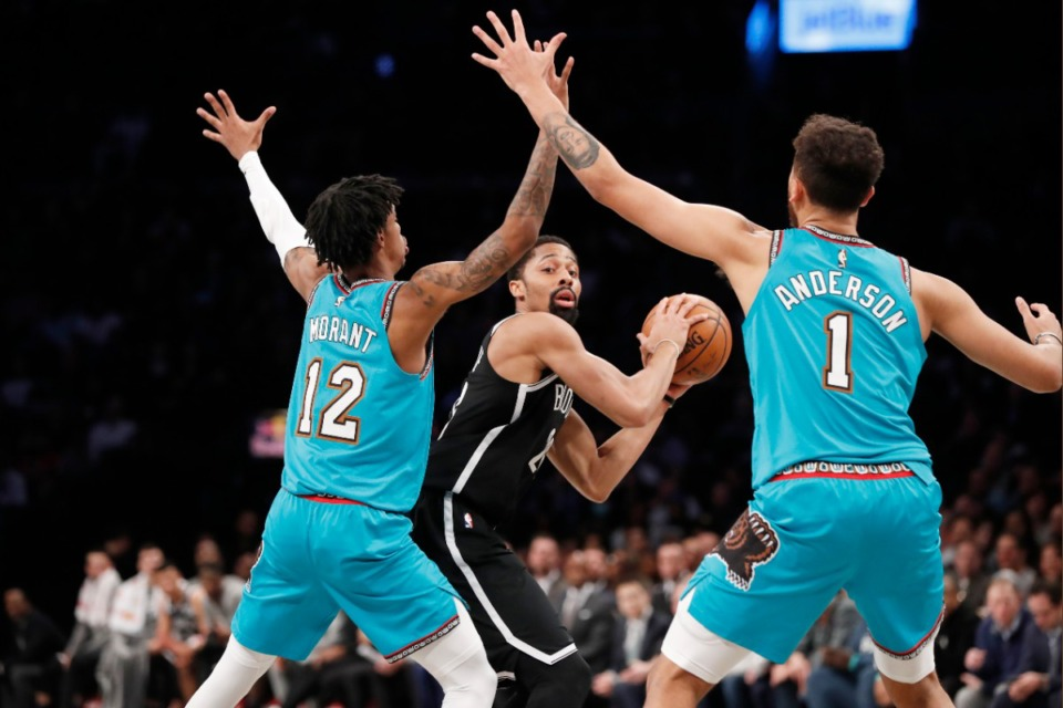 <strong>Brooklyn Nets guard Spencer Dinwiddie, center, looks to pass with Memphis Grizzlies guard Ja Morant (12) and Grizzlies forward Kyle Anderson (1) defending him during the second quarter of an NBA basketball game Wednesday, March 4, 2020, in New York.</strong> (Kathy Willens/AP)