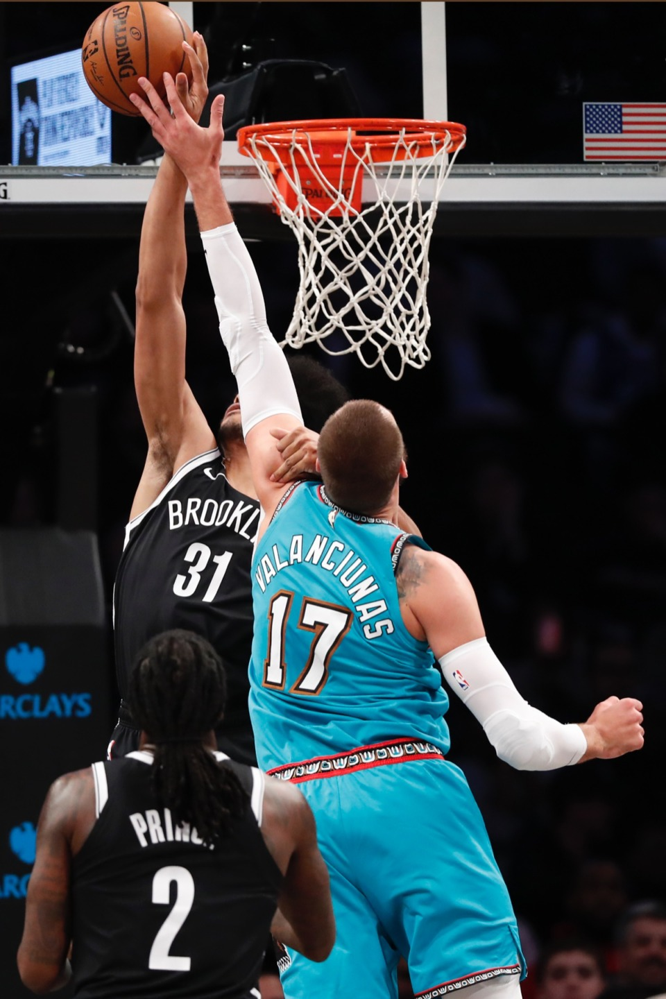 <strong>Brooklyn Nets center Jarrett Allen (31) grabs the shooting arm of Memphis Grizzlies center Jonas Valanciunas (17) and fouls him March 4, 2020, in New York. Brooklyn Nets forward Taurean Prince (2) watches from the floor, lower left.</strong> (Kathy Willens/AP)