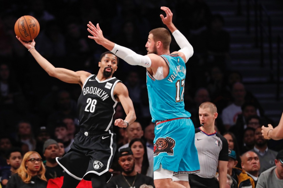 <strong>Brooklyn Nets guard Spencer Dinwiddie (26) passes around Memphis Grizzlies center Jonas Valanciunas (17) March 4, 2020, in New York.</strong> (Kathy Willens/AP)