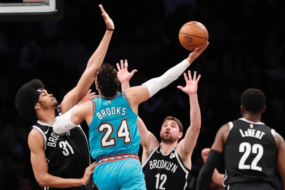 <strong>Brooklyn Nets center Jarrett Allen (31) and Nets forward Joe Harris (12) defend against a shot by Memphis Grizzlies guard Dillon Brooks (24) March 4, 2020, in New York. Brooklyn Nets guard Caris LeVert (22) watches, lower right.</strong> (Kathy Willens/AP)