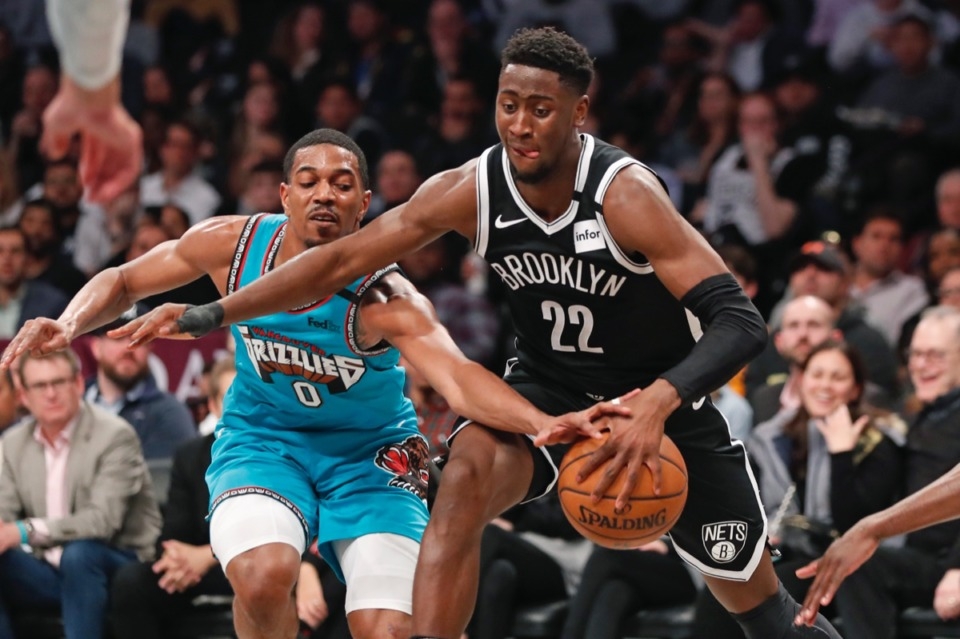 <strong>Memphis Grizzlies guard De'Anthony Melton (0) tries to strip the ball from Brooklyn Nets guard Caris LeVert (22) as LeVert drives to the basket March 4, 2020, in New York.</strong> (Kathy Willens/AP)